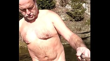 Skinny dipper with erection in public...