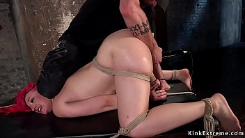 Busty redhead slave gaped and toyed