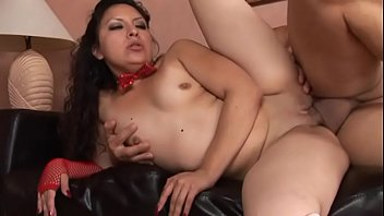 Latin brunette floozie with massive keyster in stripped red white stockings and red bow tie fucks with well set dude