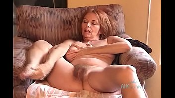 Hot red haired granny Donna plays with her self