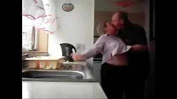 Mum and dad home alones having fun in the kitchen. Hidden cam mature mom