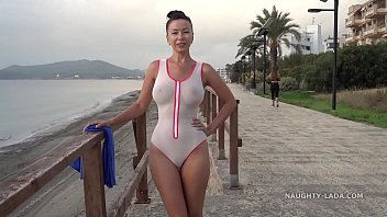 Naughty Lada wears see-through swimsuit in public beach