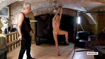 Slut spreading her legs to let whipped...