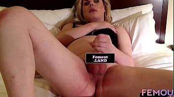 Trap beauty stroking her swollen dick