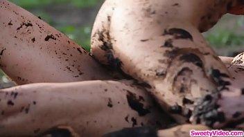 Lesbian couple scissoring on the mud