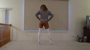 Tanned Blonde Crossdresser in Daisy Dukes and Thigh Boots