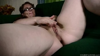 Horny BBW lies back and fucks her soaking wet pussy for you