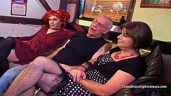 Pale redhead younger crossdresser sucking old mans cock...