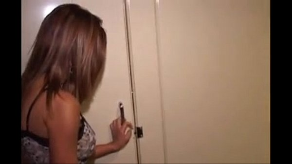 Hotty giving a blowjob in the public bathroom