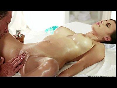 Oiled brunette fucked by masseur