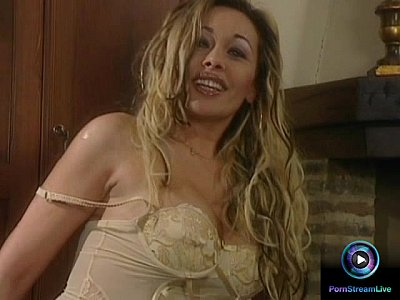 Bosomy Antonella del Lago playing with her sex toy beside the fireplace