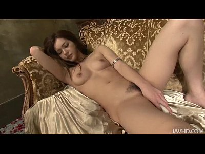 Lovely Mei looks fantastic in and on gold as she toys her sweet Japanese pussy