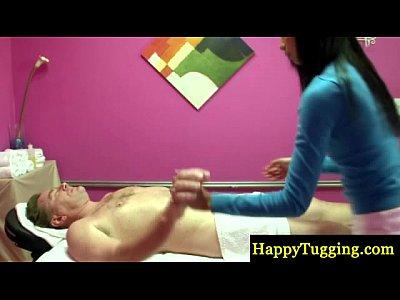 Asian masseur gives a sexy rub down