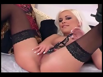 Pretty blonde glamour babe teases and masturbates in lingerie and heels