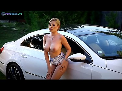 Busty Donna Bell fingering her wet twat on her sports car