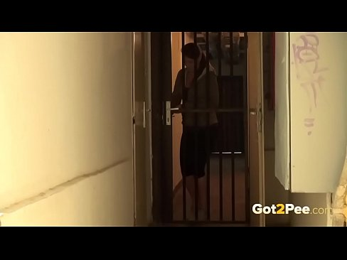 Pee Desperation - Hot brunette relieves herself outside in a doorway