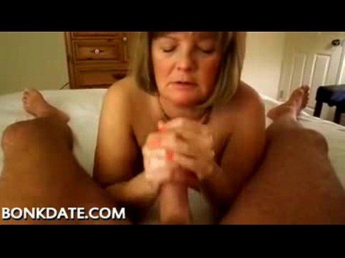 Mature gives handjob and swallows cum