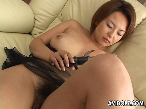 Slut rubs her cunt with her lovely sex toy