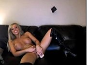 blonde in leather boots cums over sofa playingw.