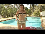 big breasted tranny babe jerking off by the pool