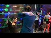 Wet girls dancing erotically in a club