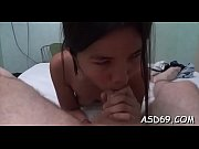 Asian slut stuffs her filthy mouth with a huge wet dicl