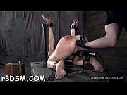 Tied up beauty waits with anticipation of her next punishment