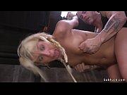 Blonde tests endurance in bondage sex