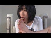 Asian girl is sucking her toes