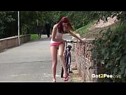 Public Peeing -&nbsp_Redhead babe Kattie pisses on a path