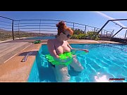 Horny redhead MILF fucks herself in the pool, until cock arrives!