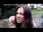 Two girls fight in a car junkyard