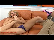 sexy blond gives footjob and gets cum on feet
