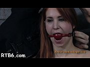 caged hotty gets a lusty whipping for her.