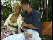 Mature blonde sucking a cock outdoor