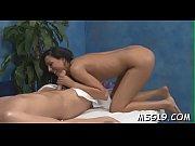 Glorious masseuse demonstrates taut ass and enhanced boobs