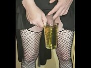 crossdressing sissy drinks his own piss and swollows the lot