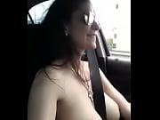 Girl singing in her car topless