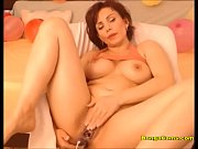 juicy milf bangs both of her holes with toys