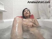 amateur asian woman masturbates in the tub with.