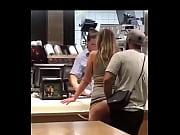 White couple having sex in restaurant