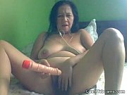 Granny masturbates with dildo on cam