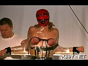 stripped woman shows off in complete breast bondage.