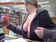 busty girl flashing in the library.