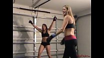 Two Cheerleaders Play with Their Toy