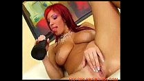 Beautiful big tits redhead plays with a giant dildo