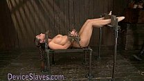 Pretty babe immobilized in metal devices