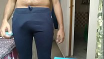 Naughty boy undressing in home