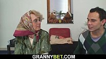 Hot four-eyed grandma spreads legs for him