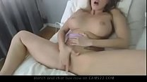 Busty American babe masturbating with realistic...